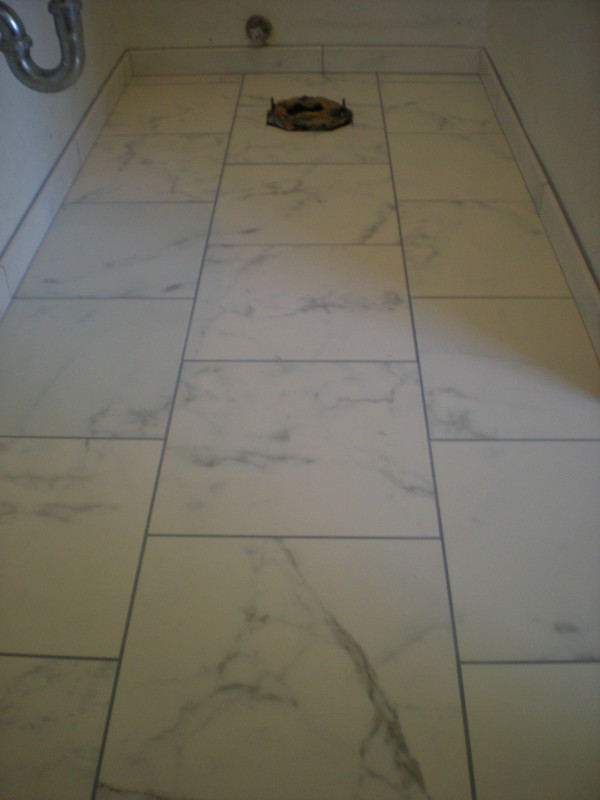 Faux marble custom tile bathroom floor and shower for Fake tile floor